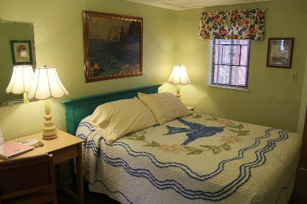 Every queen-bed room features unique vintage decor.  This is Room 5.