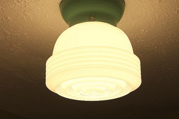 The vintage (many of them original) light fixtures add to the period charm.