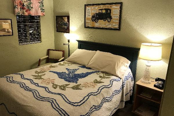 From the barkcloth curtains, to the vintage lamps, to the candlewick bedspread, your room will take you back in time.