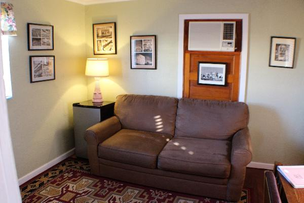 The sofa in the parlor is a comfortable place to relax, read, or watch TV. The suite also features an in-room refrigerator for your convenience.
