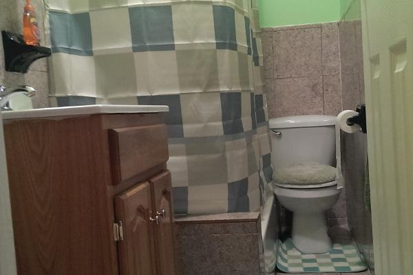 Our cozy bathroom cleaned daily by our staff