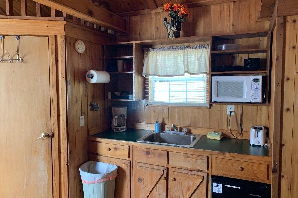 Cabins are equipped with small kitchenette, refrg, coffee pot, toaster