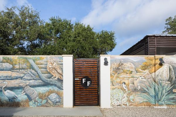 Art wall featuring local flora and fauna welcomes you.
