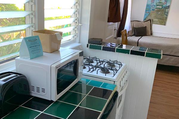 Kitchen with microwave, refridgerator, and stove.