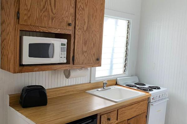 Kitchen with microwave, refrigerator, oven, and stove.