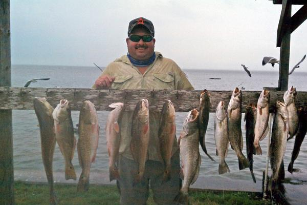 Capt Gorham with many fish