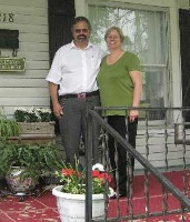 Maple Street Bed and Breakfast Innkeepers Cliff and Janie Neeley on the front porch of their home.