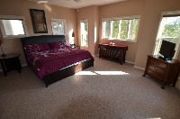 Large Master Bedroom with high-def TV and plenty of natural light