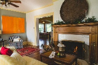 Our inviting living room with working fireplace!