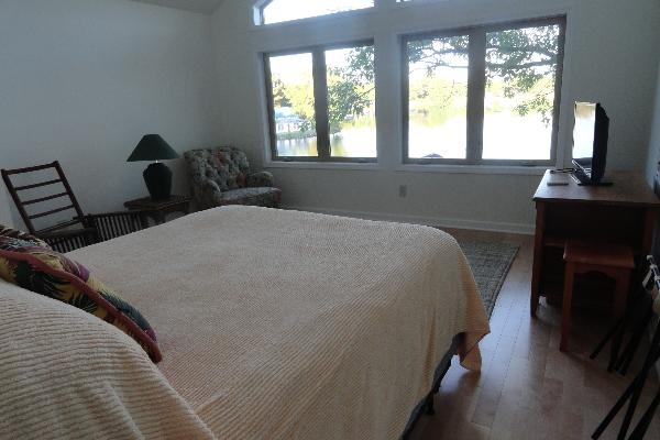 Second floor front bedroom with queen bed and river view