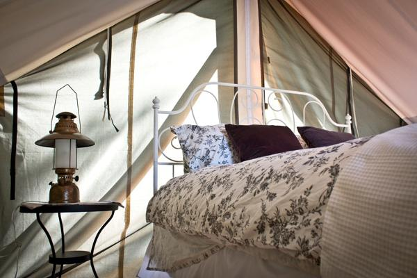 The Frog Tent is situated in a peaceful, wooded nook. Beautiful slivers of sunlight shine through its pale canvas tent walls, creating ethereal surroundings.